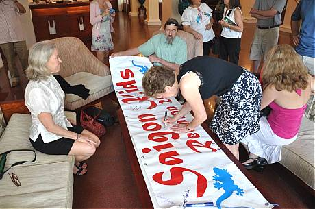 Signing The Reunion 2009 Banner at Continental Hotel March 15, 2009