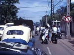 Lambretta Riding Over Taxi